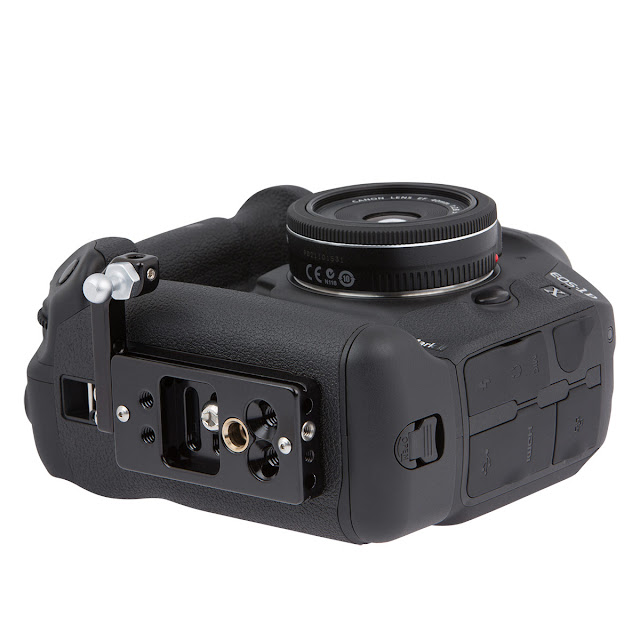 http://www.promediagear.com/PAH1-Bracket-Plate-Adapter-for-Straps-or-Camera-Carrying-Devices_p_243.html