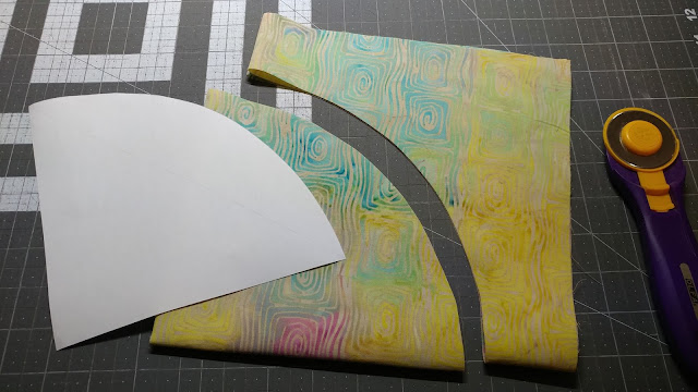 Cutting circles for my Open weaving circle quilt using Island Batik fabrics