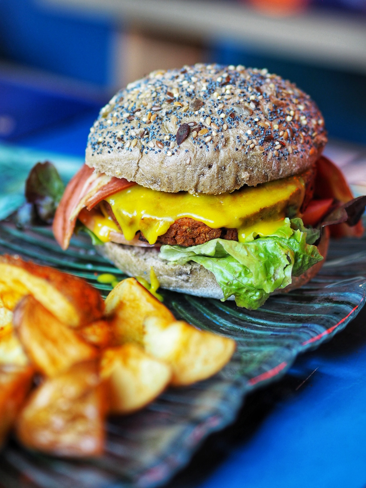 "The ""New York"" style burger with a meat-like patty, vegan cheese and vegan bacon from Floripa Vegan Food & Cocktail Bar Barcelona"