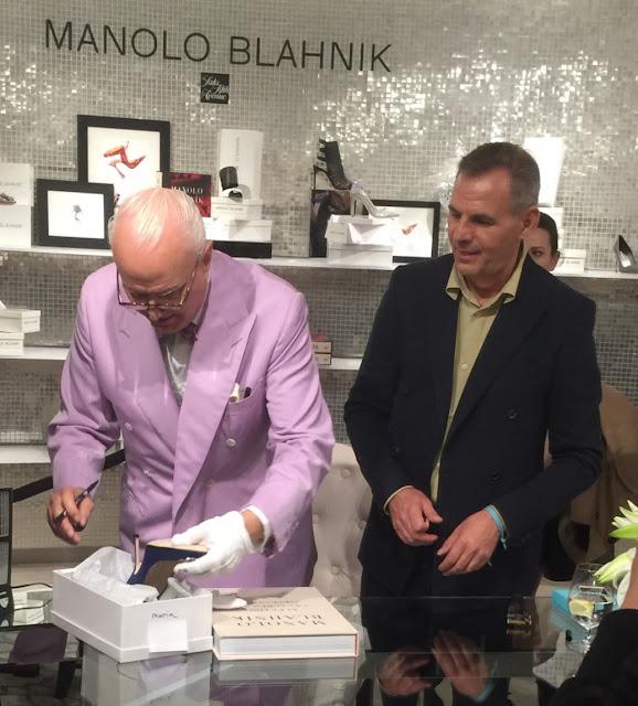 The designer himself signing shoes
