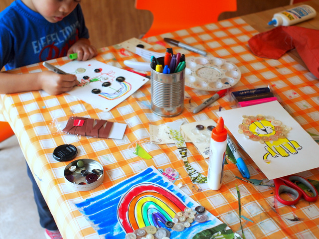 Invitation to create with buttons- make button art collages with the kids