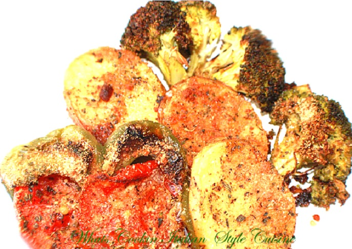 roasted vegetable medley with zucchini, eggplant, carrots, potatoes, peppers and onions with bread crumbs and cheese on top baked