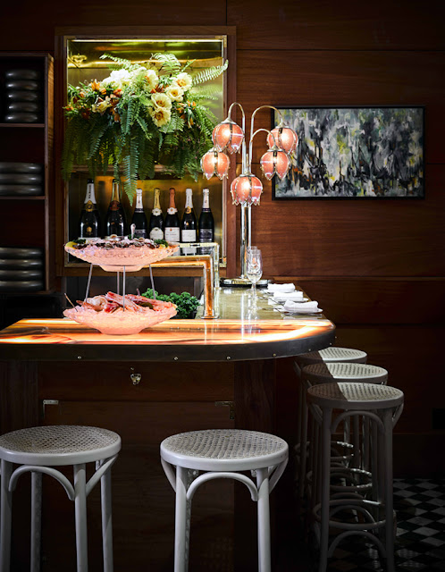 Dramatic colorful tropical decor bar by Ken Fulk