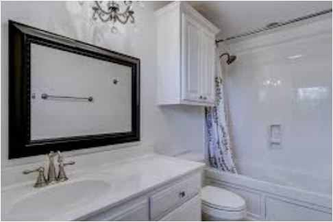 the idea of adding a bathroom cabinet