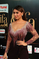 Hansika Motwani in Glittering Deep Neck Transparent Leg Split Purple Gown at IIFA Utsavam Awards 38.JPG