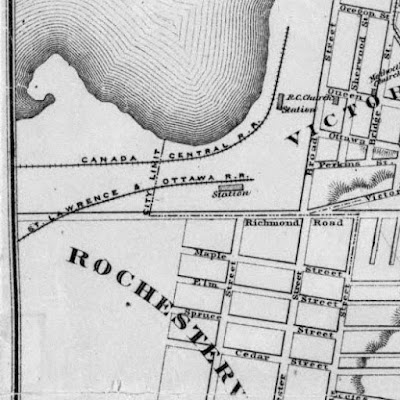 Section of an 1874 map at the west end of Ottawa, with extent Bridge/Division Street (Booth, East), Eccles Street (South), West of City Limits (West), Oregon St (just south of Ottawa River at Booth, North). Richmond Road crosses the entire section of map. The City limit comes northbound from the bottom of the map up Division Street, turns west (left) on Richmond Road, then turns north (right) west of Broad Street in the middle of nowhere, opposite where Champagne Ave (City Centre Ave) will later be (but nothing is drawn west of Preston). Two rail lines come in from the west: The Canada Central R.R. (C.P.R.) along the Ottawa River which turns north around Nepean Bay to become parallel with Broad Street, where there is a station between Queen and Ottawa streets. The other rail line, St. Lawrence & Ottawa R.R. (C.A.R.), comes onto the map just south of Richmond Road and crosses it at a shallow angle before arriving at its station west of Broad opposite Preston Street, just inside City Limits. Outside City Limits, Rochesterville is labelled as the area west of Division and south of Richmond Road.