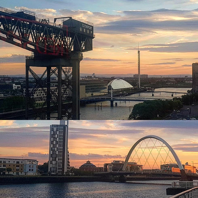 The sun sets over the river Clyde in Glasgow painting the sky red-orange, striking a contrast with the iconic Finnieston Crane and bridges of Glasgow.