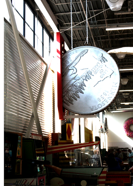 Large scale Minnesota quarter and arcade games at Can Can Wonderland