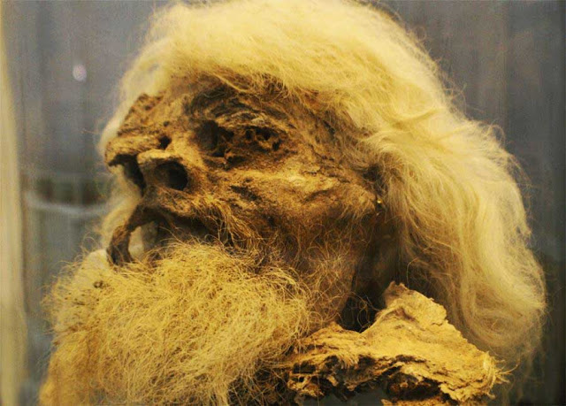 The ancient salt man with long white hair in national museum of Iran.