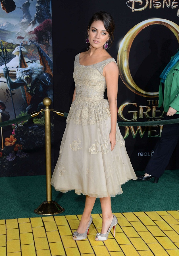 Mila Kunis dresses up in Dolce & Gabbana at the premiere of 'Oz the Great and Powerful' in LA