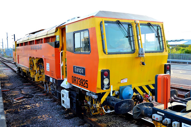 Photo of railway track machine DR73925 'Europa' on sidings at Ely railway station