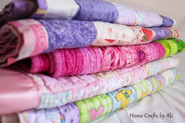 soft and colorful pile of baby quilts