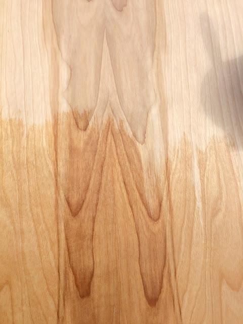 DIY your own barn style door using a slab and pocket door hardware.