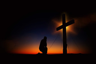 https://www.pexels.com/photo/man-kneeling-in-front-of-cross-161089/