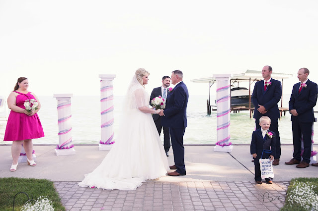 bride and groom at ceremony new baltimore waterfront wedding