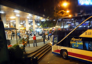 A double-decker bus at a highway station
