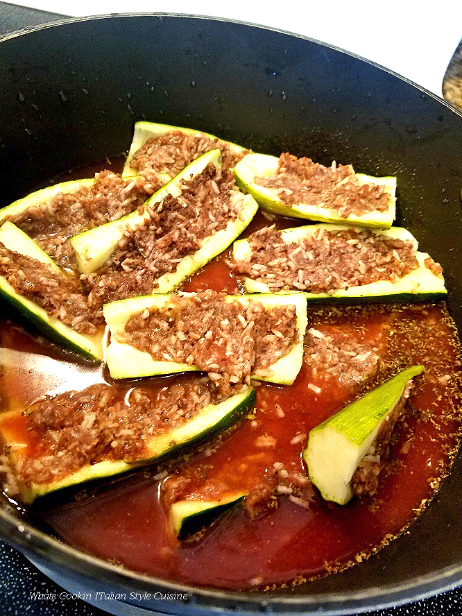 this is a baked stuffed squash that is loaded with cooked rice, tomato sauce and lamb or beef