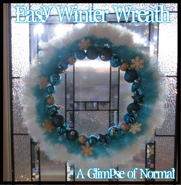 I love a pretty wreath on my front door.  That is why I decided to create this cute, easy wreath that is perfect for the front door all winter long.  Check it out over at A Glimpse of Normal.