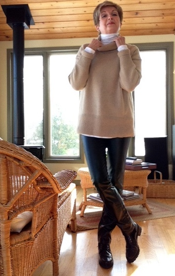 White Vince turtleneck, camel wool and cashmere Babaton sweater from Aritzia, black Holt Renfrew brand leather trousers, black Stuart Weitzman Brogan ankle boots