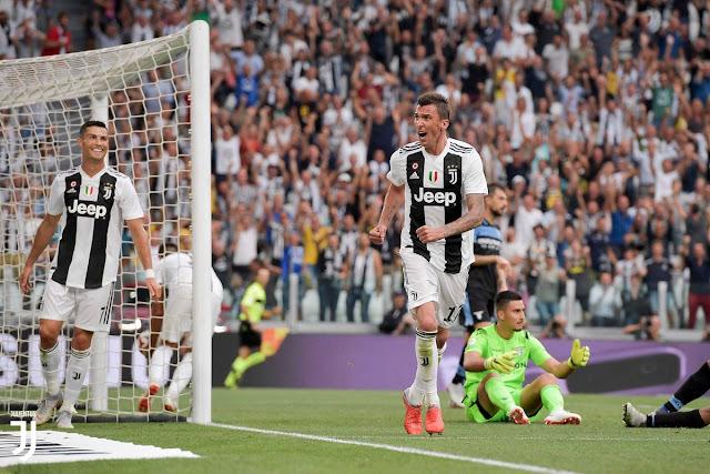 Cristiano Ronaldo looks on as Mario Mandzukic celebrates Juventus' second goal against Lazio on August 25 2018