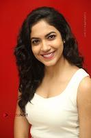 Actress Ritu Varma Stills in White Floral Short Dress at Kesava Movie Success Meet .COM 0196.JPG