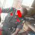 NEWS: Nigerian Policeman Spotted Sleeping With His Rifle While On Duty (Photos)