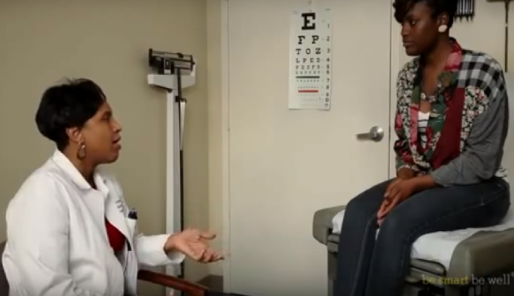 Woman talking with a doctor