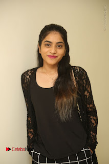 Actress Punarnavi Bhupalam Stills in Black Dress at Pittagoda Press Meet  0009.JPG
