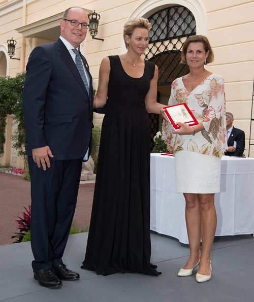 Princess Charlene wore AKRIS silk crepe striped dress and Stuart Weitzman Sandal. Princess Caroline, Beatrice Borromeo, Princess Gabriella