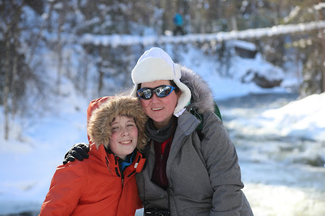 Mother and son posing by the river in Oulanka National Park