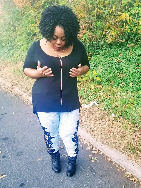 Plus size blogger with thick thighs and round hips in statement jeans and stacked booties