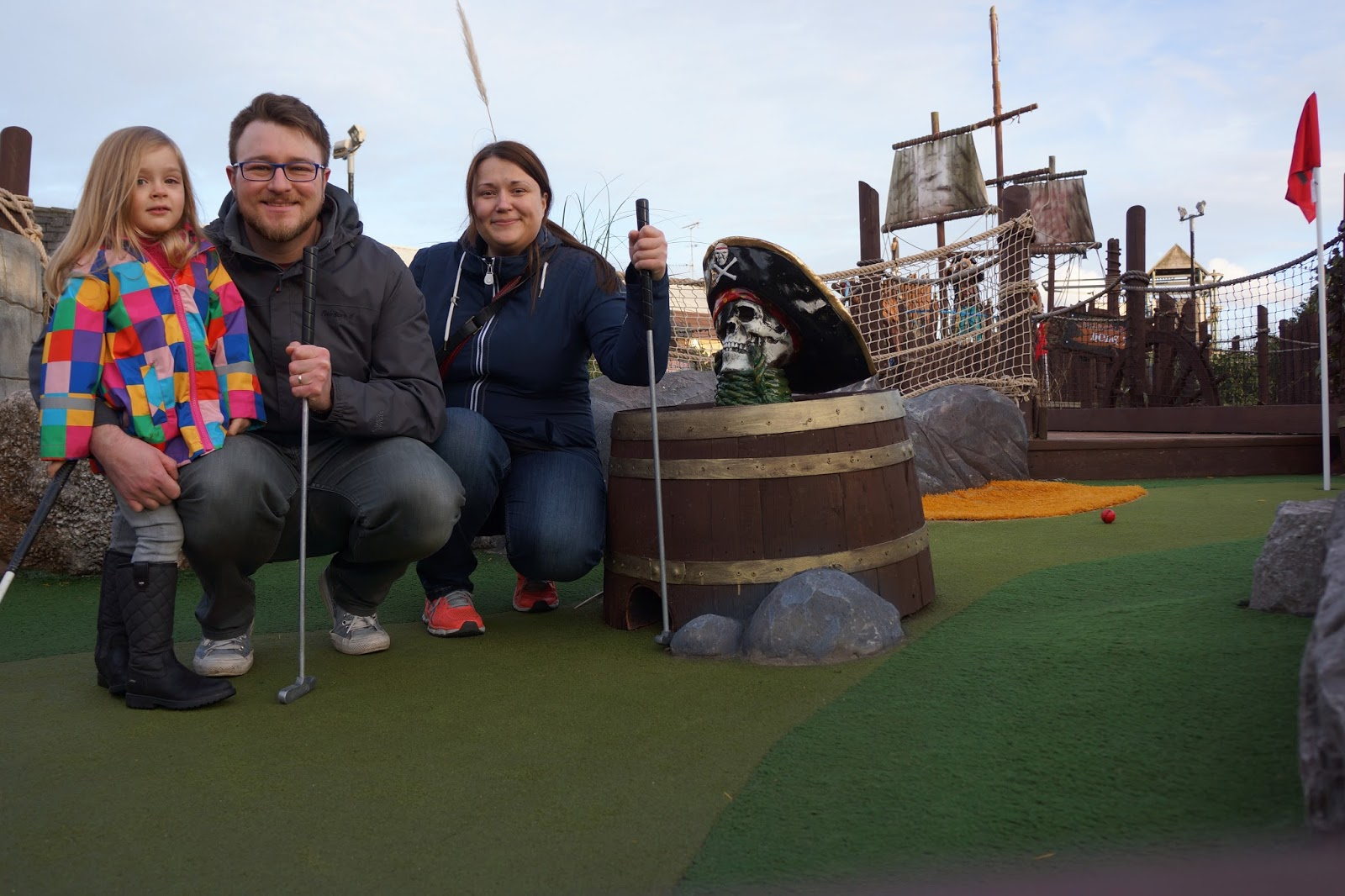 family portrait at mini golf range at butlins