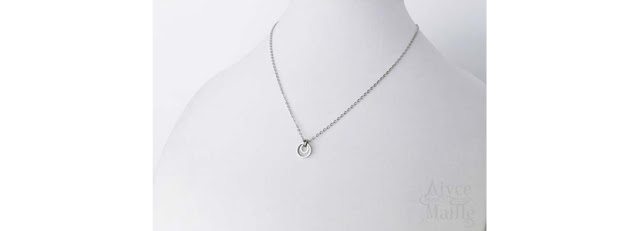 Alyce n Maille Eclipse Stainless Steel Pendant Worn by Ellen Tamaki on Charmed Episode 111