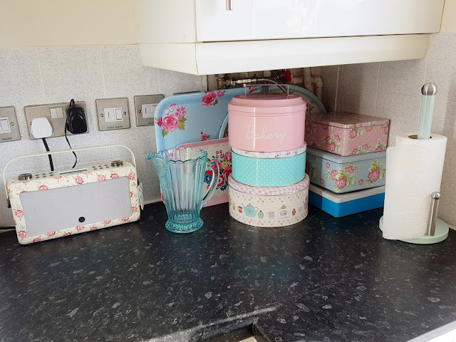 pretty cake tins in kitchen