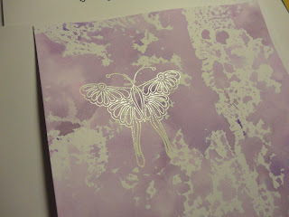 White butterfly stamped image on a splodgy purple background