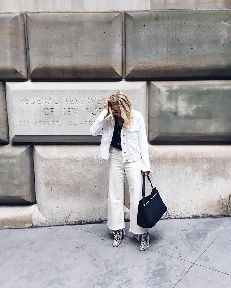 Rachel Comey white legion jeans, Loeffler Randall snake bootie, Warby Parker Dorothy sunglasses, Céline large edge bag, J Brand white denim jacket, Verameat wishbone necklace