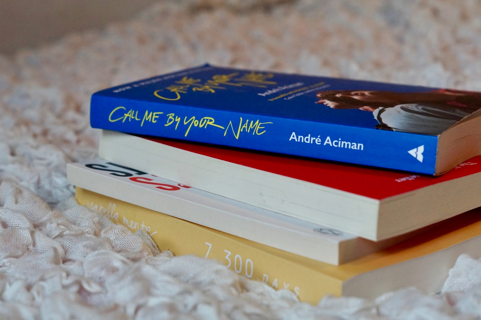 a pile of books call me by your name