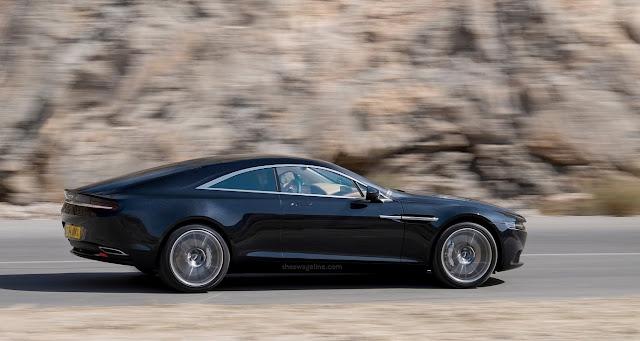 Lagonda GT luxury car driving down road