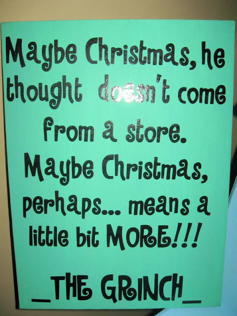 """A homemade Grinch party decoration on a green canvas with black lettering. The canvas has a quote, """"Maybe Christmas, he thought doesn't  come from a store. Maybe Christmas,  perhaps...means a little bit more"""" and the quote is  attributed  to The Grinch"""