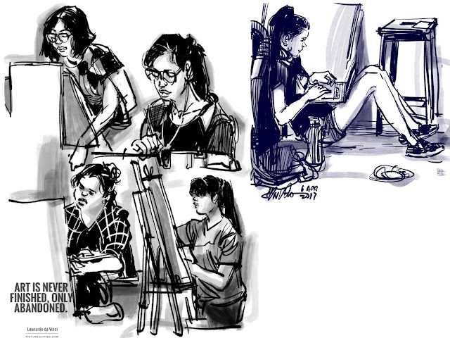 sketching students at work
