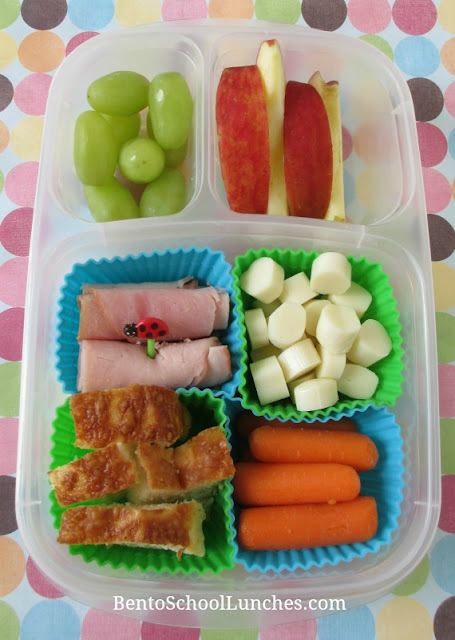 Luncables with cheese, ham, cheese bread, carrots, apple, grapes