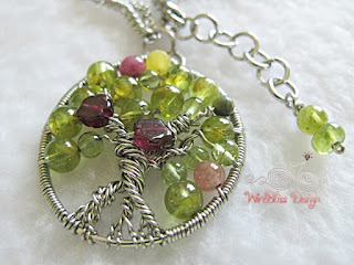 Wire Wrapped Tree of Life Pendant with peridot, garnet and tourmaline