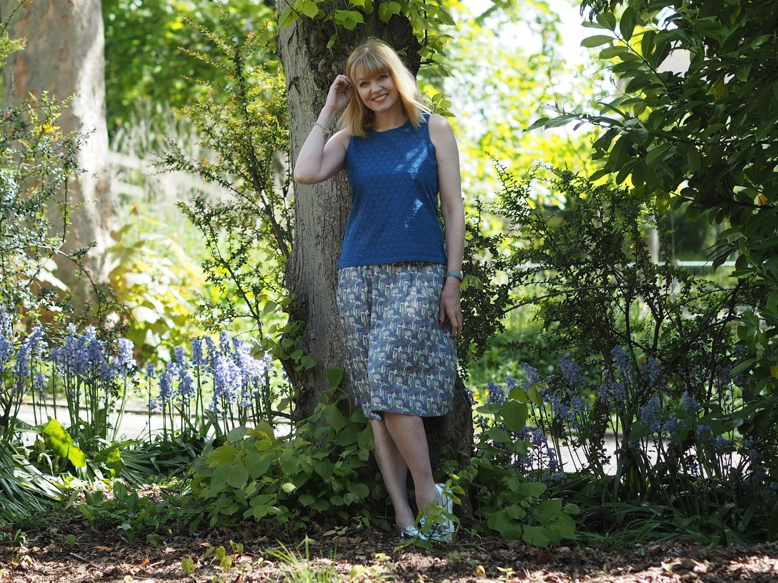 What-Lizzy-Loves-cobalt- blue-broderie-shell-top-floral-skirt-silver-Superga-sneakers-pumps