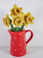 http://www.ravelry.com/patterns/library/springtime-wreath-daffodils