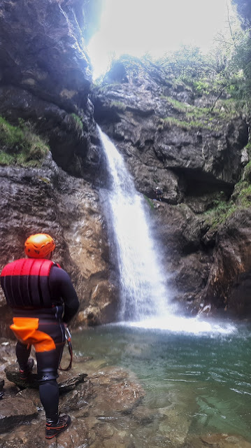 Canyoning rappel down waterfall at rio Nero Valle di Ledro Valley Trentino