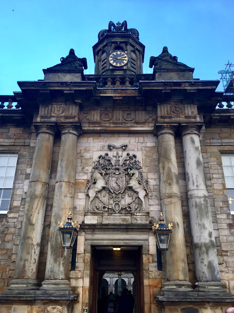 Entrance with Scottish coat of arms to the Palace of Holyrood House, Edinburgh, Scotland