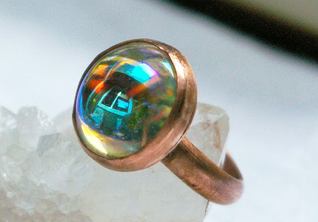 https://www.etsy.com/ca/listing/618476372/vintage-ab-glass-dome-copper-ring-half