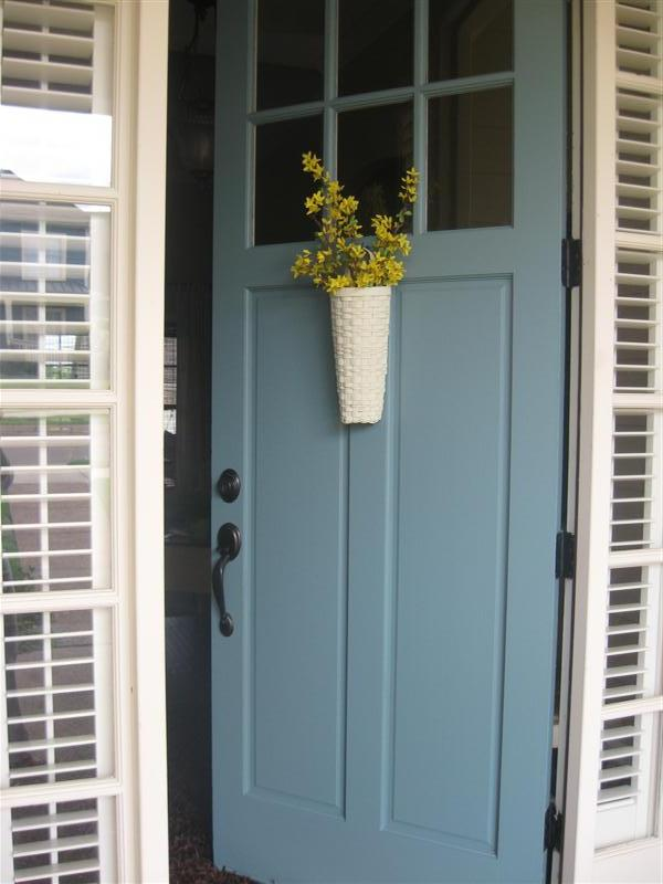 Magnolia Bend Drive: A blue door and a kitchen window box