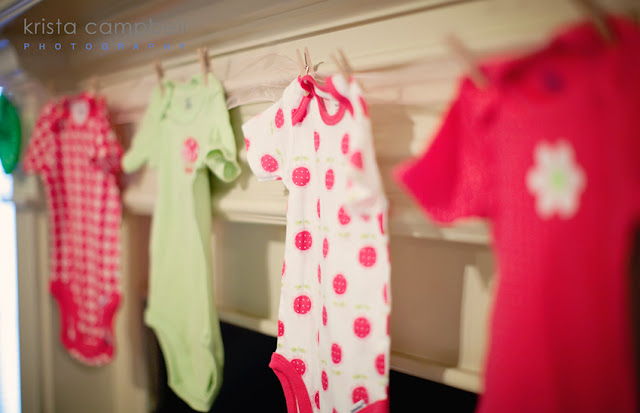 onesies hanging up, clothespins, onesie decor, baby shower decor ideas
