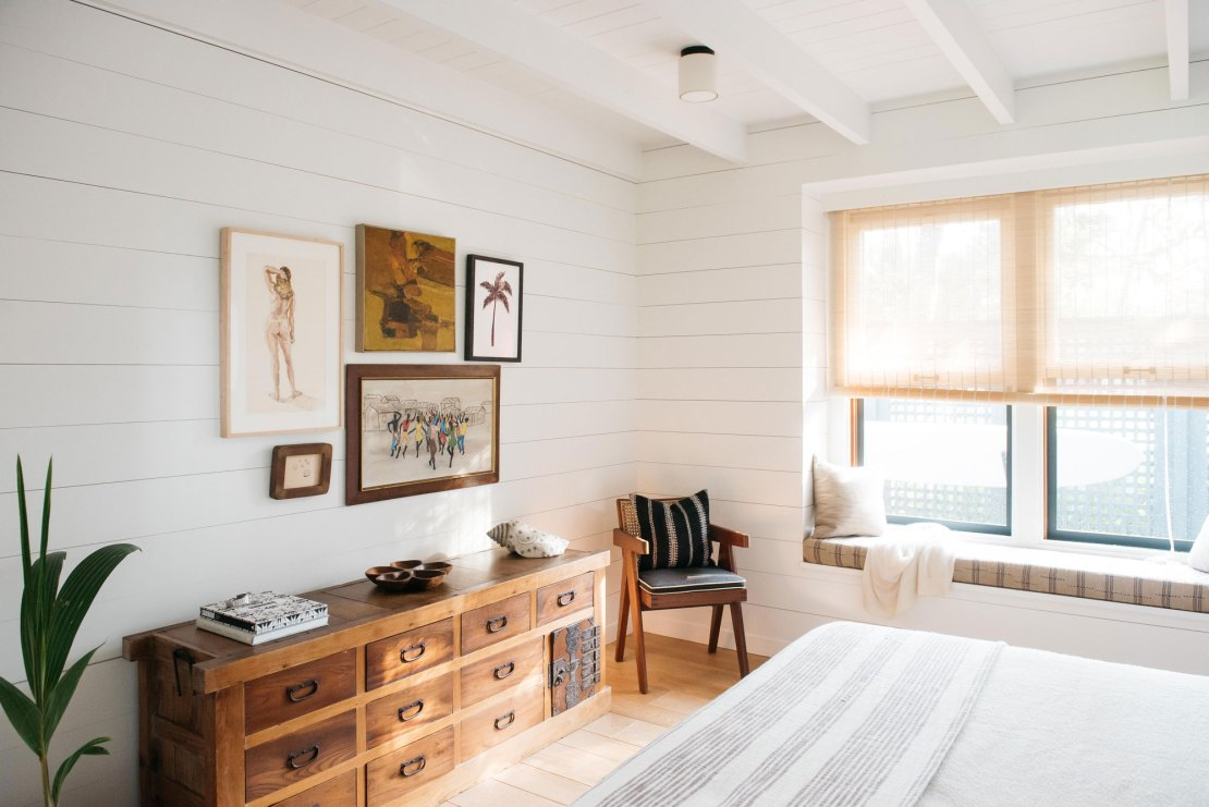 Gorgeous rustic modern white bedroom with shiplap in Maui Beach Cottage - seen on Hello Lovely Studio